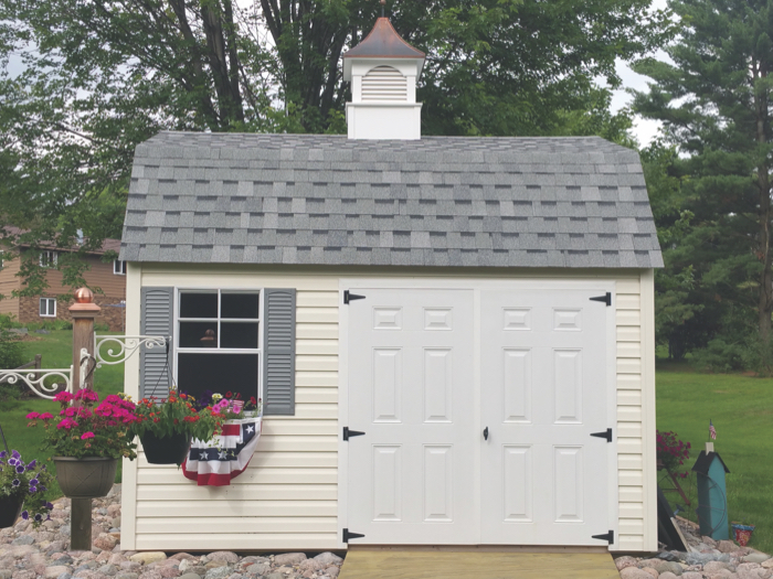 lofted garden shed with shingled roof